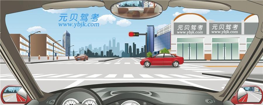 駕駛機動車在這個路口怎樣右轉彎行駛?A、沿直行車道右轉彎B、停止線前停車等待C、沿右側道路右轉彎D、借非機動車道右轉答案是C