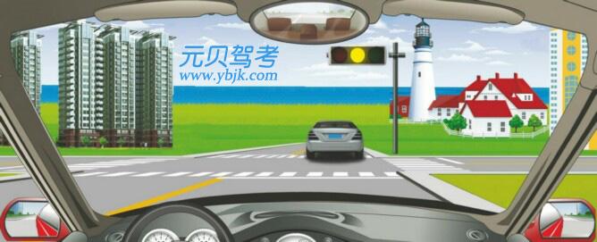 駕駛機動車在路口遇到這種信號燈表示什么意思?A、路口警示B、禁止右轉C、準許直行D、加速通過答案是A